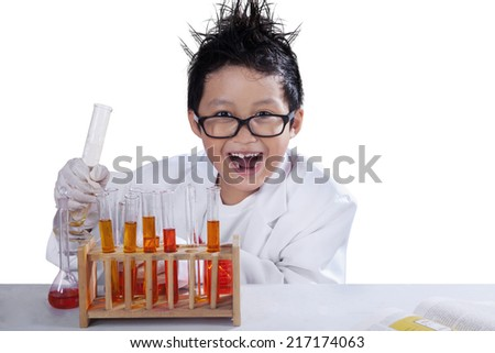 Portrait of little mad scientist doing research, isolated over white background - stock photo