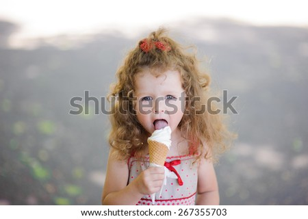 Portrait of Little pretty girl with ice cream  - stock photo