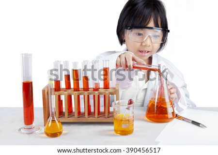 Portrait of little schoolgirl wearing lab coat and doing research, isolated on white background - stock photo