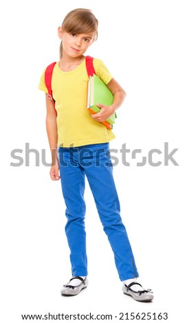 Portrait of little schoolgirl with backpack holding a book, isolated over white - stock photo