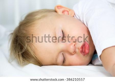 Portrait of Little Sleeping Baby - stock photo
