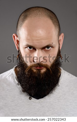 portrait of long beard and mustache hipster - stock photo
