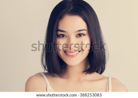 Portrait of long hair Asian woman with white shirt. Vintage style. - stock photo