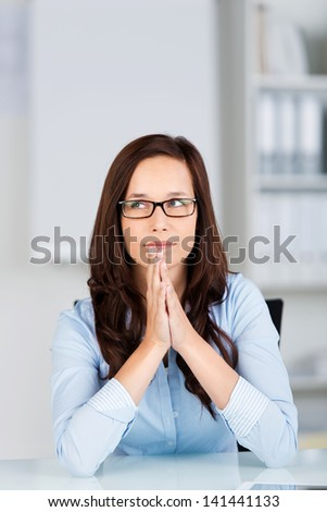 Portrait of looking up woman and thinking in a close up shot - stock photo