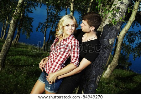 Portrait of love couple embracing outdoor in park - stock photo