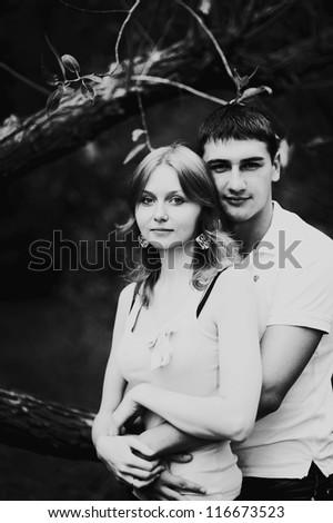 Portrait of love couple embracing outdoor  looking happy - stock photo