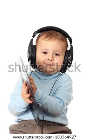 Portrait of lovely child in headphones - stock photo