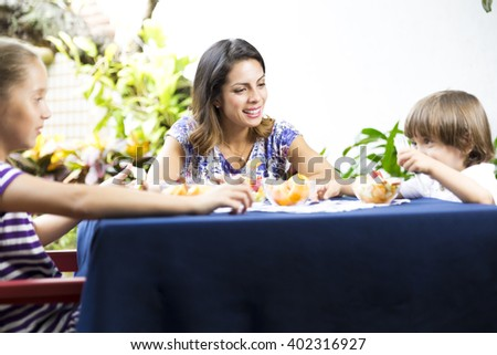 Portrait of Lovely Family Having Picnic - stock photo