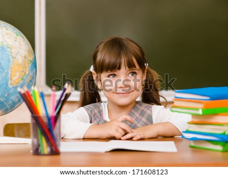 Portrait of lovely girl in classroom - stock photo