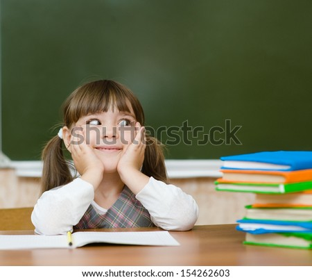Portrait of lovely girl in classroom. looking to the left - stock photo