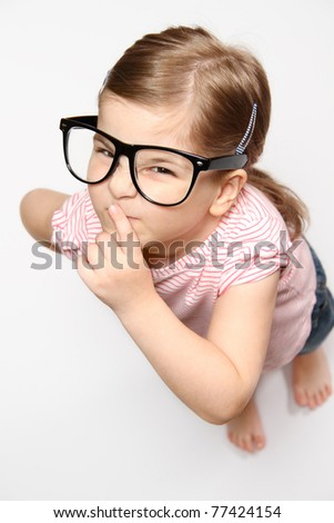 Portrait of lovely smiling girl in glasses - stock photo