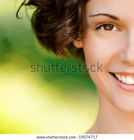 Portrait of lovely smiling girl, on green background. - stock photo