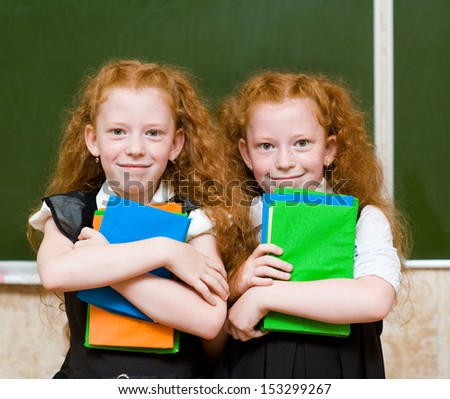 Portrait of lovely twins girls. looking at camera - stock photo