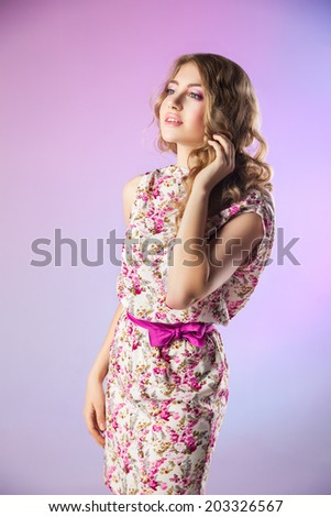 portrait of lovely woman in romantic dress on purple background - stock photo