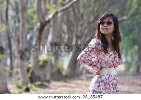 Portrait of lovely woman in the forest - stock photo