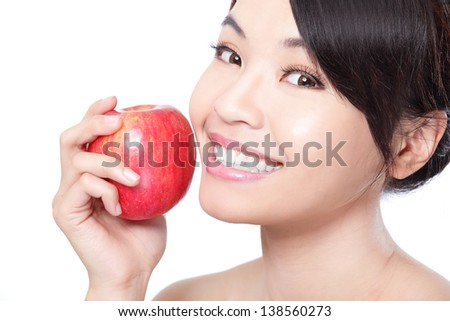 Portrait of lovely young woman holding a fresh ripe apple and smiling with health teeth isolated on white background, asian beauty - stock photo