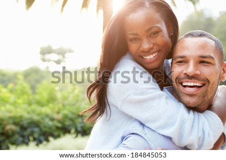Portrait Of Loving African American Couple In Countryside - stock photo