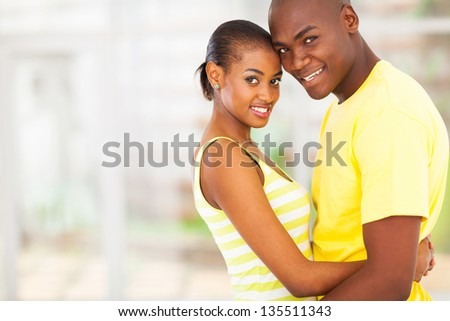 portrait of loving african couple hugging - stock photo