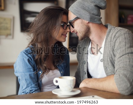 Portrait of loving couple at cafe  - stock photo