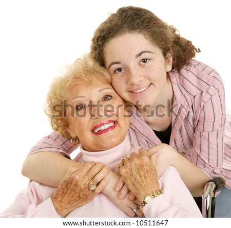 Portrait of loving grandmother and affectionate teen granddaughter.  White background. - stock photo