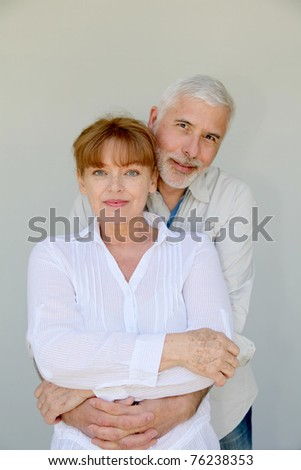 Portrait of loving senior couple - stock photo