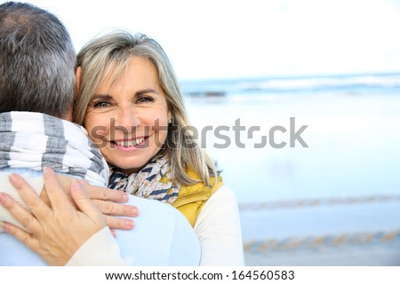 Portrait of loving senior couple at the beach - stock photo