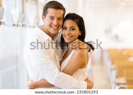 portrait of loving young couple embracing - stock photo