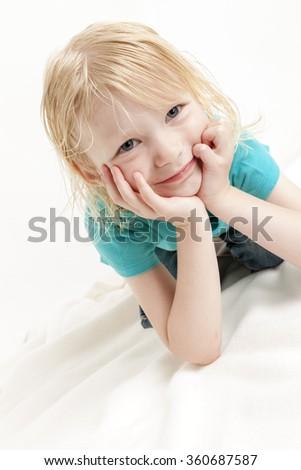 portrait of lying little girl - stock photo