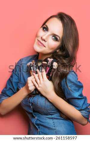 portrait of make up artist woman with makeup brushes near face. beauty concept - stock photo
