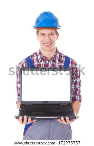 Portrait Of Male Architect Holding Laptop Over White Background - stock photo