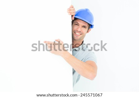 Portrait of male architect with bill board over white background - stock photo