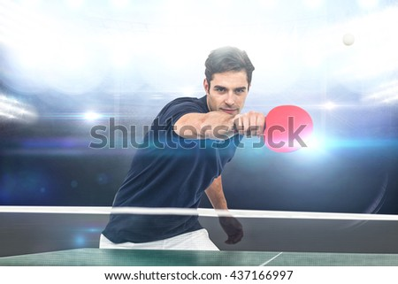 Portrait of male athlete playing table tennis against american football arena - stock photo