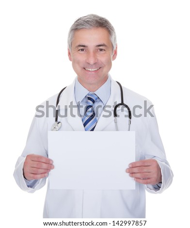 Portrait Of Male Doctor Holding Placard Over White Background - stock photo