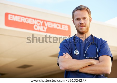 Portrait Of Male Doctor Standing Outside Hospital - stock photo