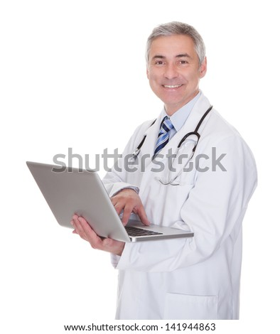 Portrait Of Male Doctor Using Laptop Over White Background - stock photo
