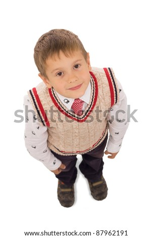 portrait of male elementary pupil on white - stock photo