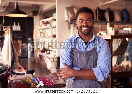 Portrait Of Male Owner Standing In Gift Store - stock photo