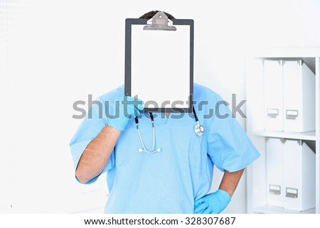 Portrait of male surgeon doctor sitting at the table in hospital office, stethoscope - stock photo