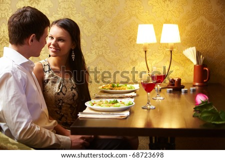 Portrait of man and woman looking at each other at meeting - stock photo