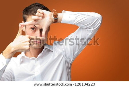 Portrait Of Man Gesturing against an orange background - stock photo