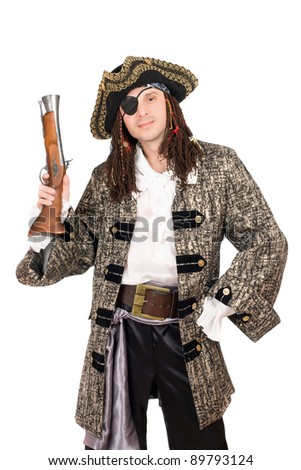 Portrait of man in a pirate costume with pistol - stock photo