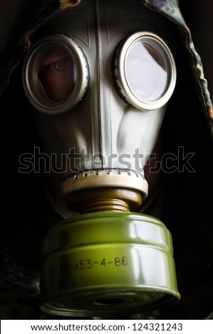 Portrait of man in gas mask - stock photo