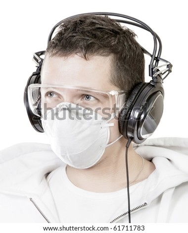 Portrait of man in mask listening music - stock photo