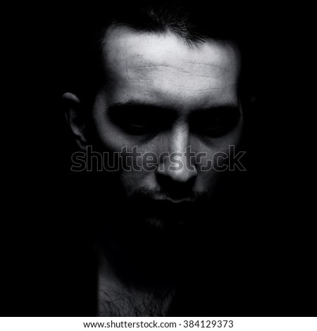 Portrait of man in shadow. Black and white. - stock photo