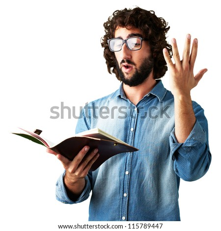 Portrait Of Man Reading Book On White Background - stock photo