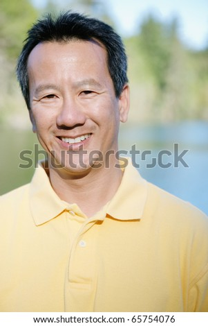 Portrait of man smiling - stock photo