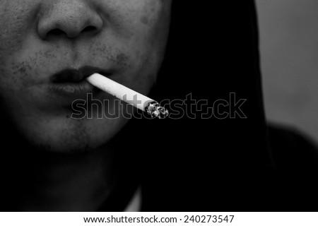 portrait of man smoking a macro - stock photo