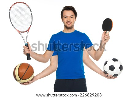 Portrait of man standing with classic soccer ball. guy holding two balls and two rackets on white background  - stock photo
