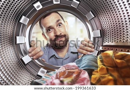 portrait of man view from washing machine inside - stock photo