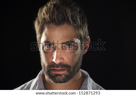 Portrait of man with facial hair. - stock photo